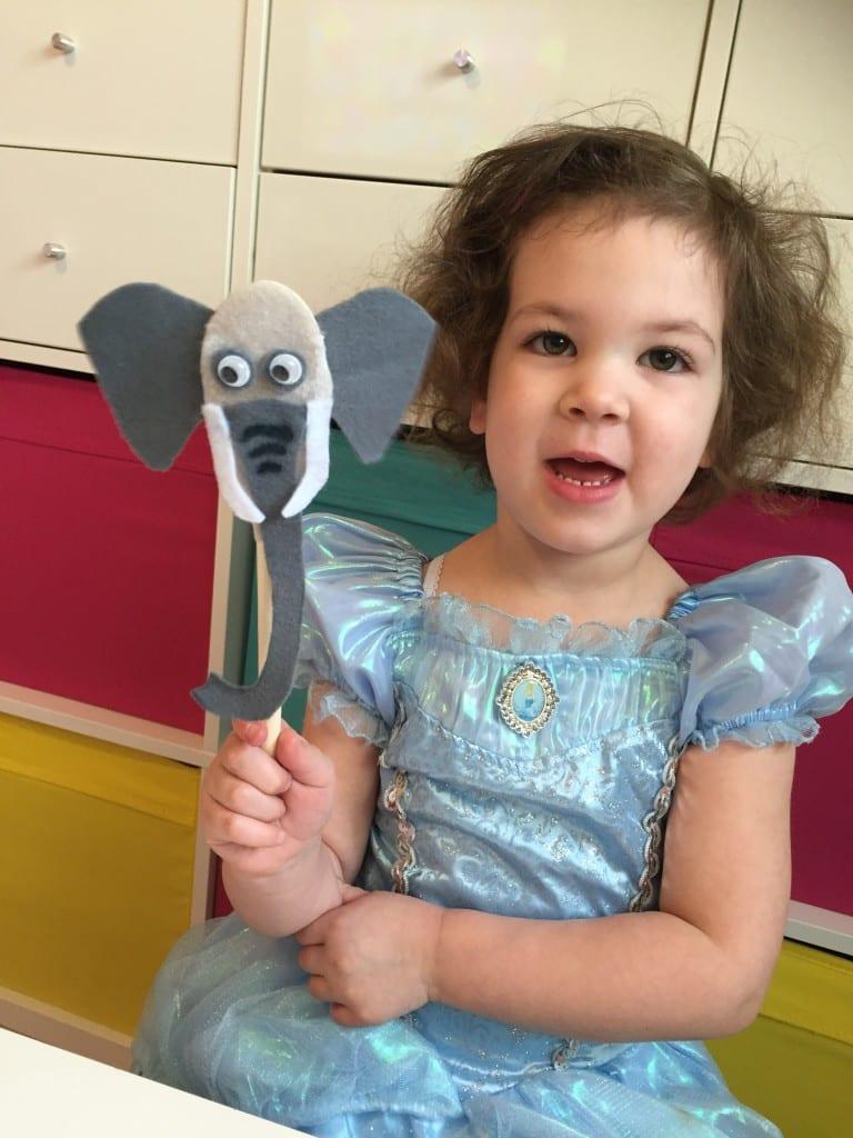 Isla proudy displaying her wooden spoon elephant