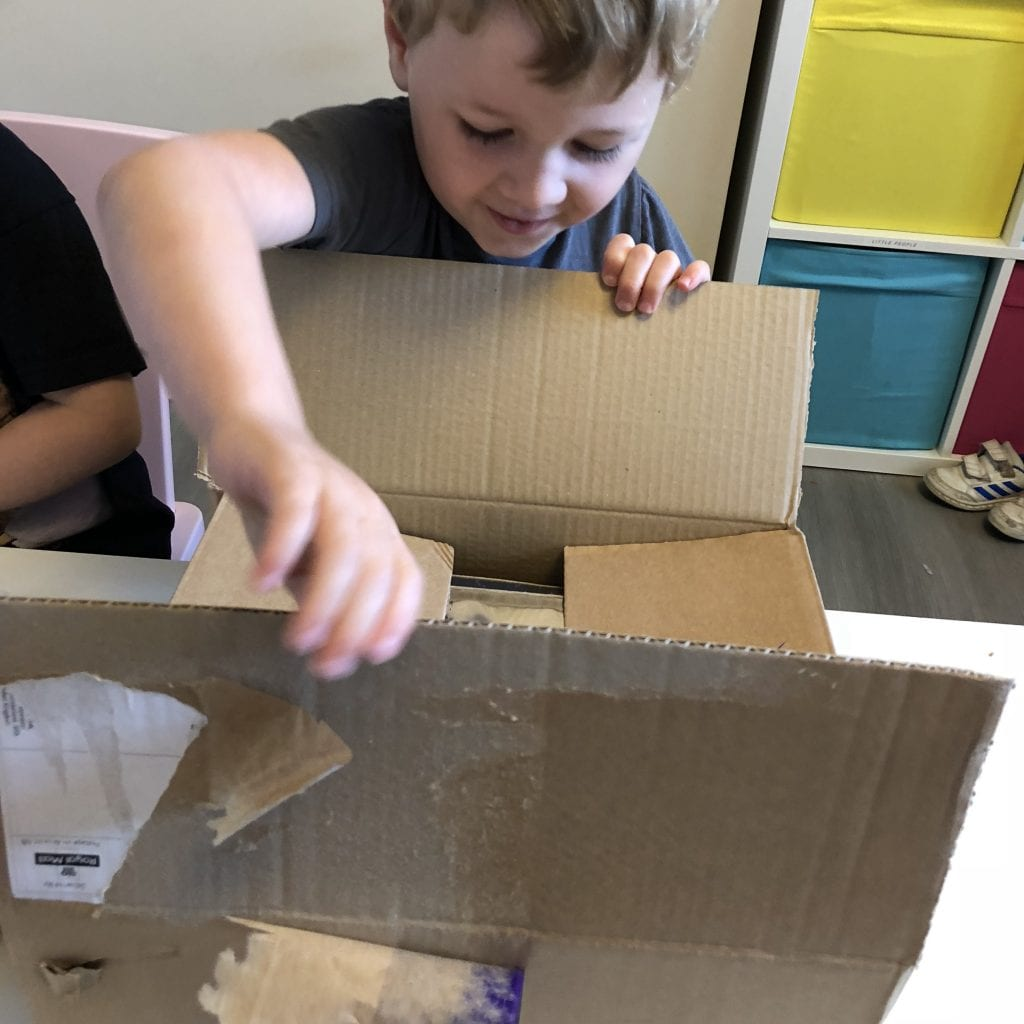 Oliver opening his space journey subscription box