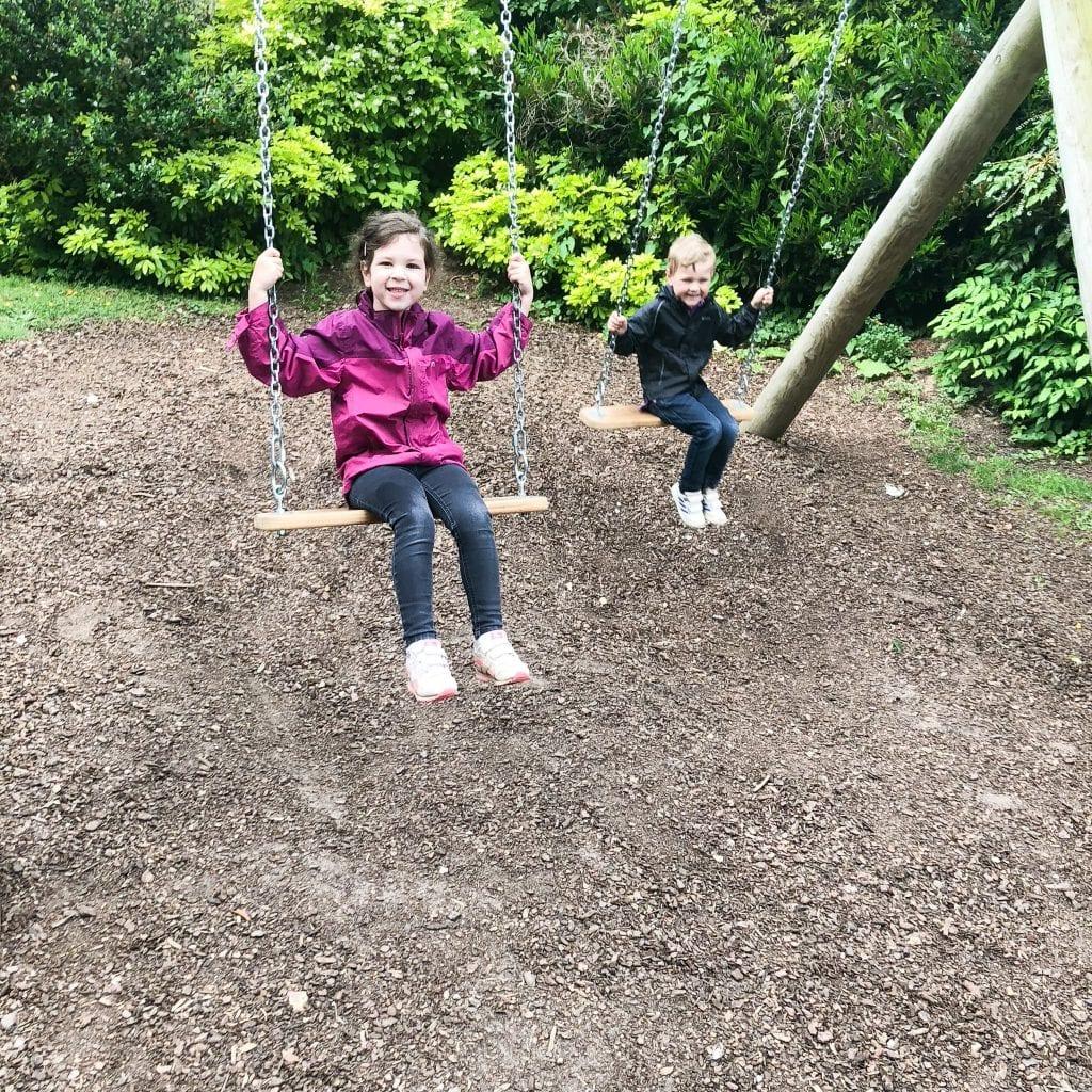Kids ahving fun on the swings!