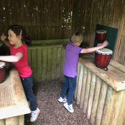 Kids playing bongos