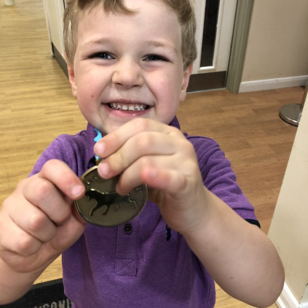 Oliver with his latest medal for his collection