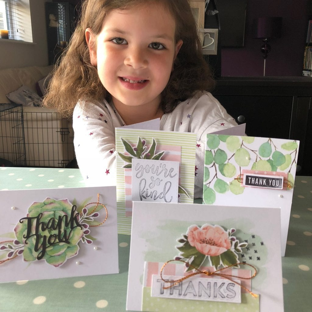 Isla with the cards she has produced