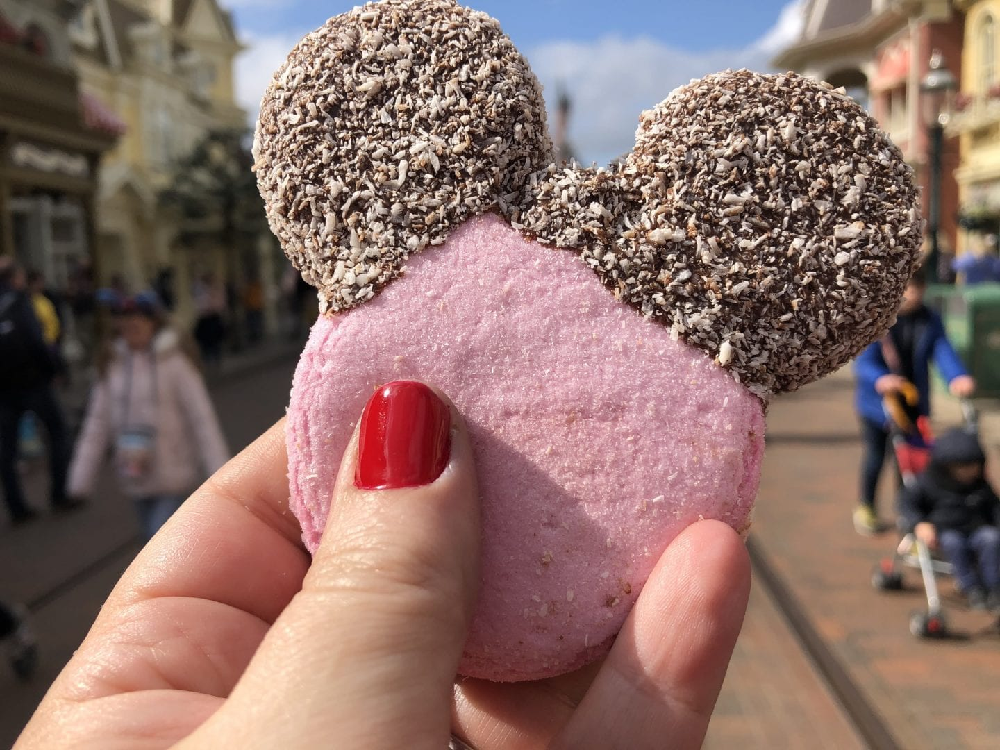 Mickey shaped marshmallow with chocolate dipped ears sprinkled with coconut