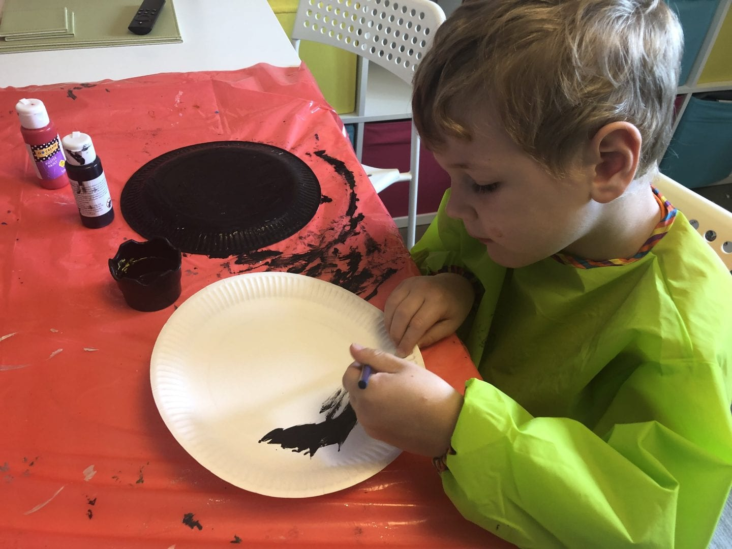 Oliver painting paper plates