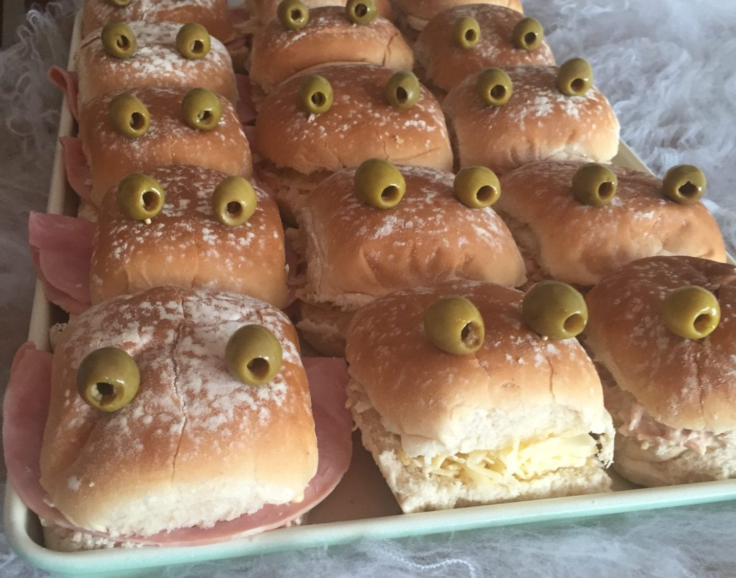Frog or Monster Rolls- ham and cheese bread rolls with olives for eyes
