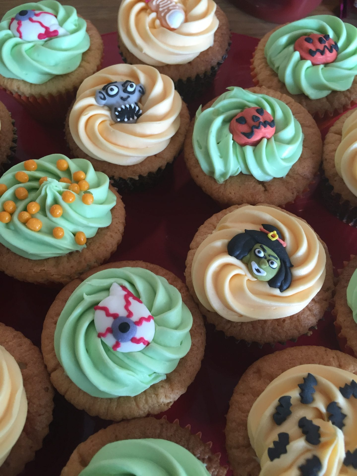 Halloween cupcakes, decortaed with coloured buttercream and shop bought Halloween sugar paste decorations