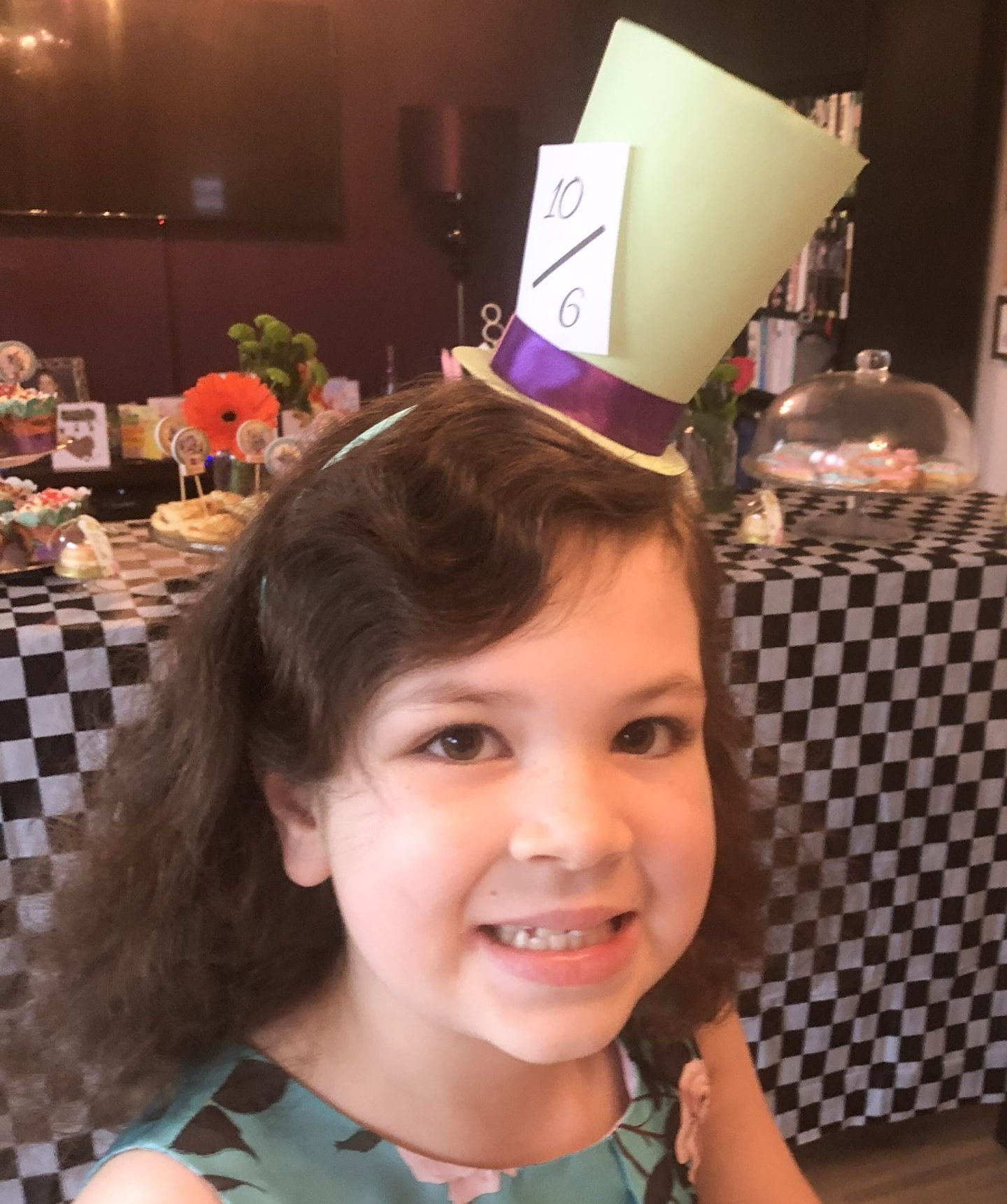 Young girl wearing her homemade Mad Hatter Headband