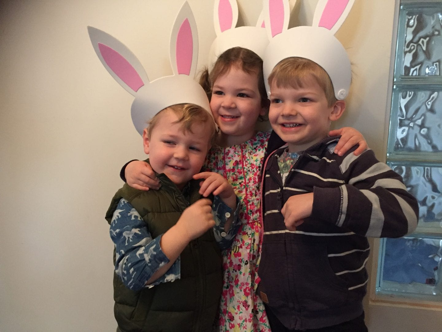 three children wearing bunny ears for Easter