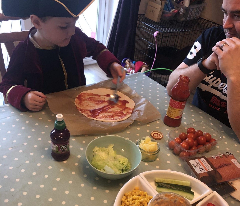 Oliver making pizza