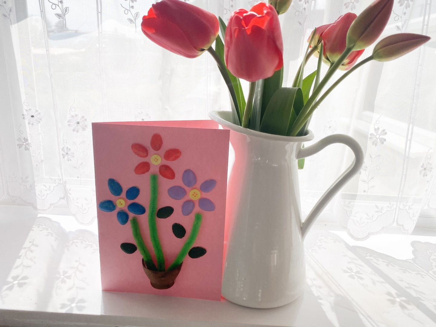 pistachio shell card next to a vase of tulips