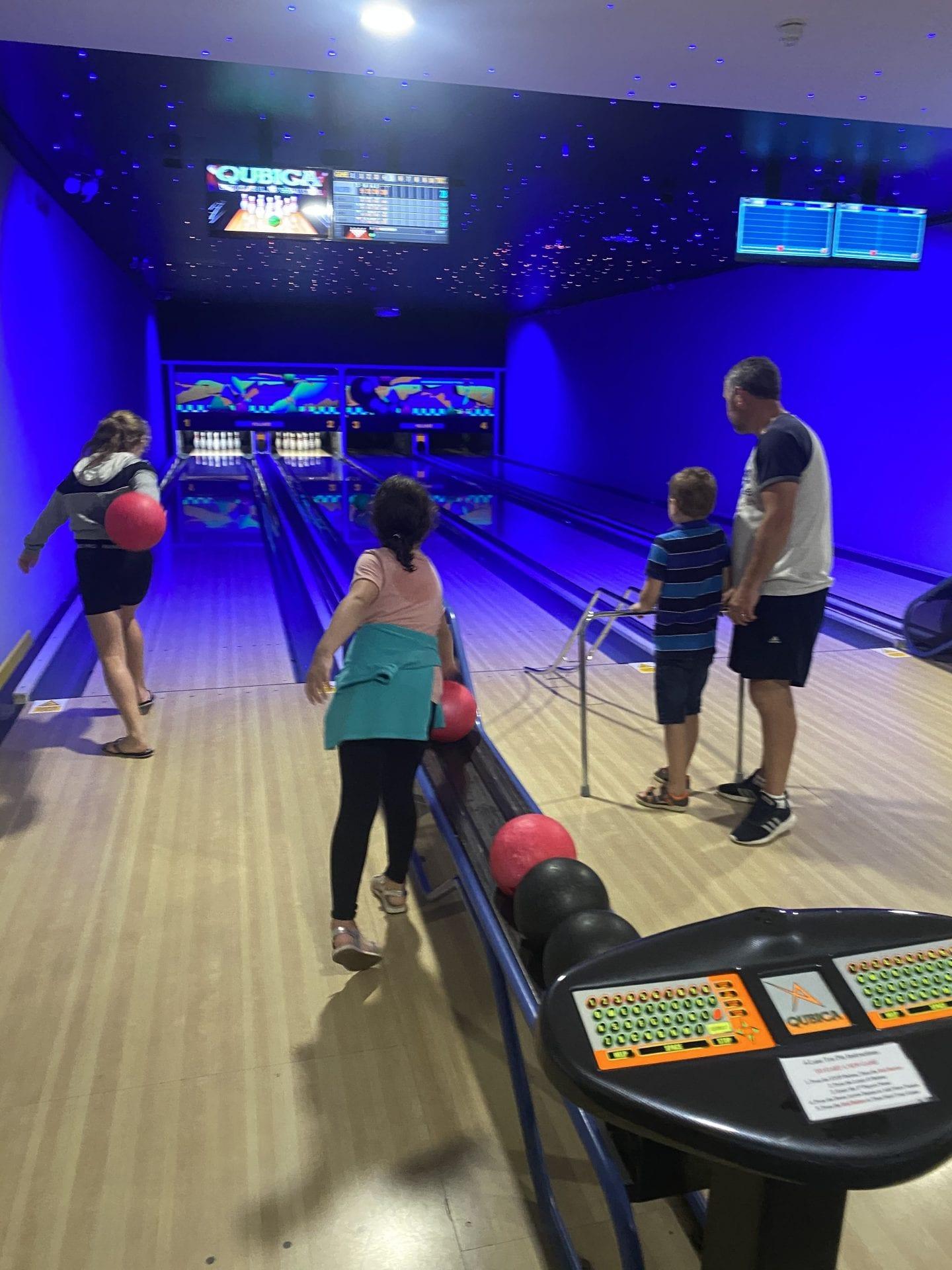 A family playing ten pin bowling