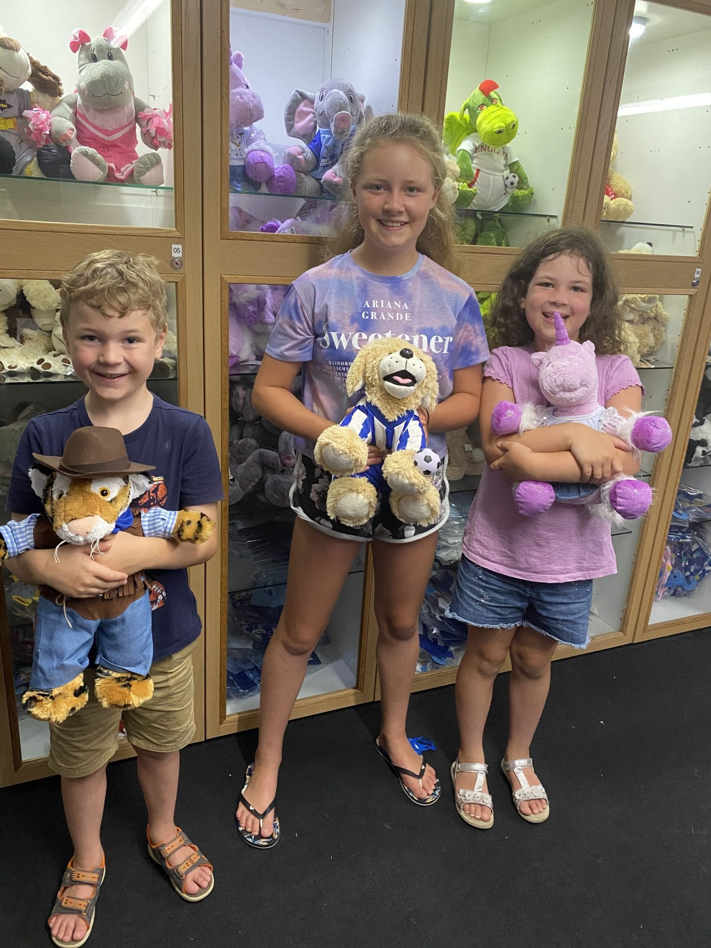 3 children holding the teddies that they had just made