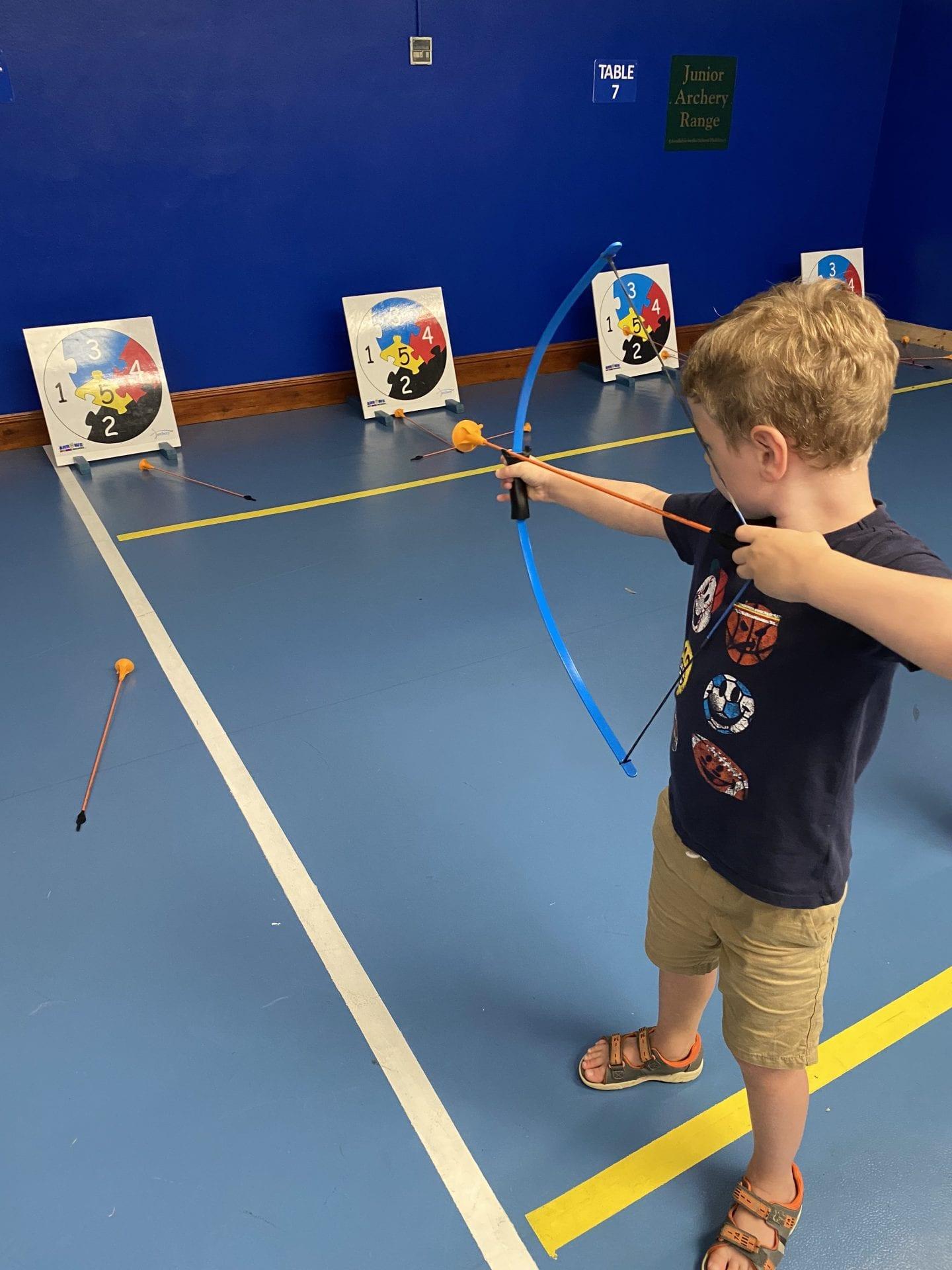 A boy doing junior archery