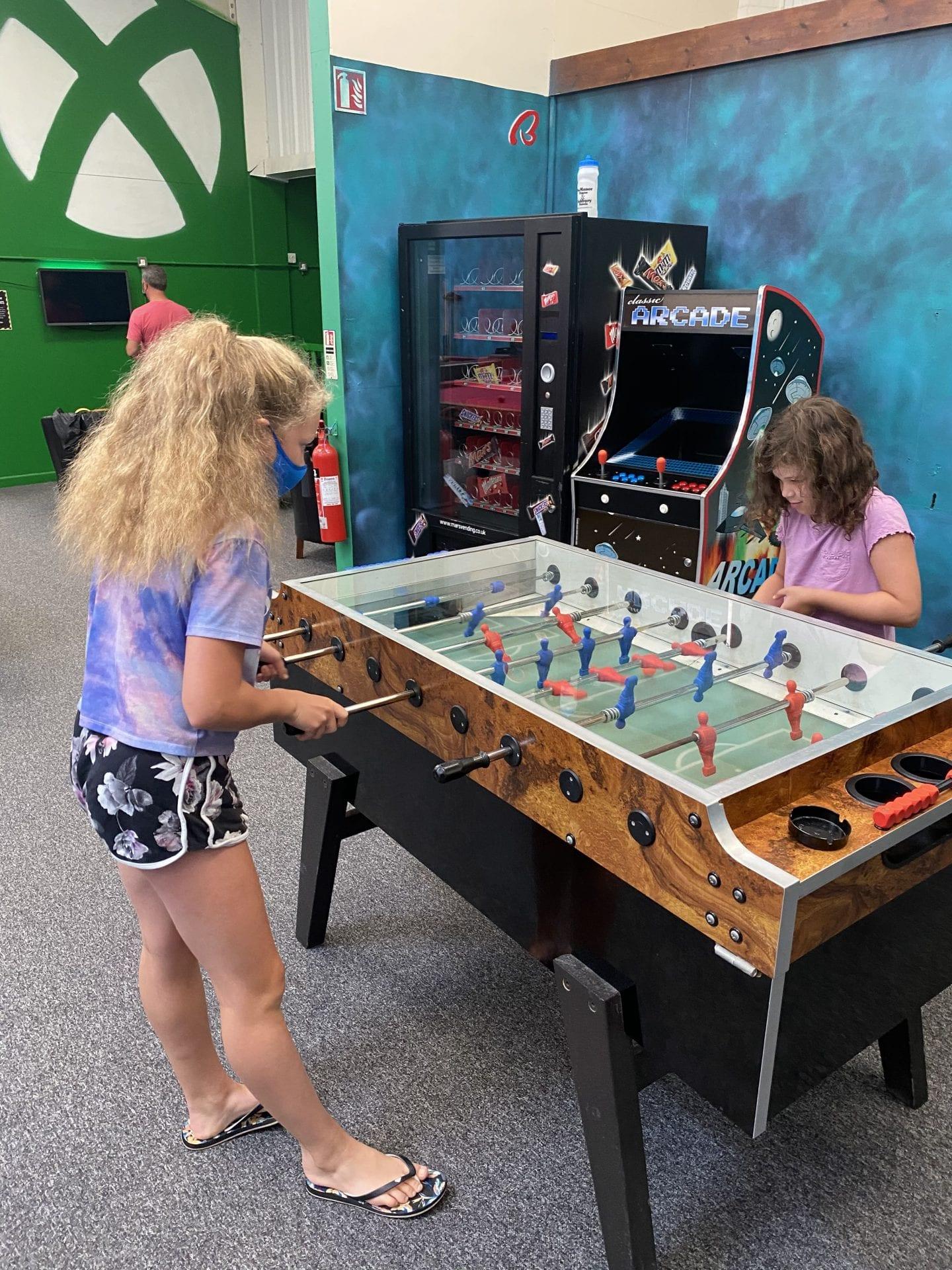 2 girls playing table football
