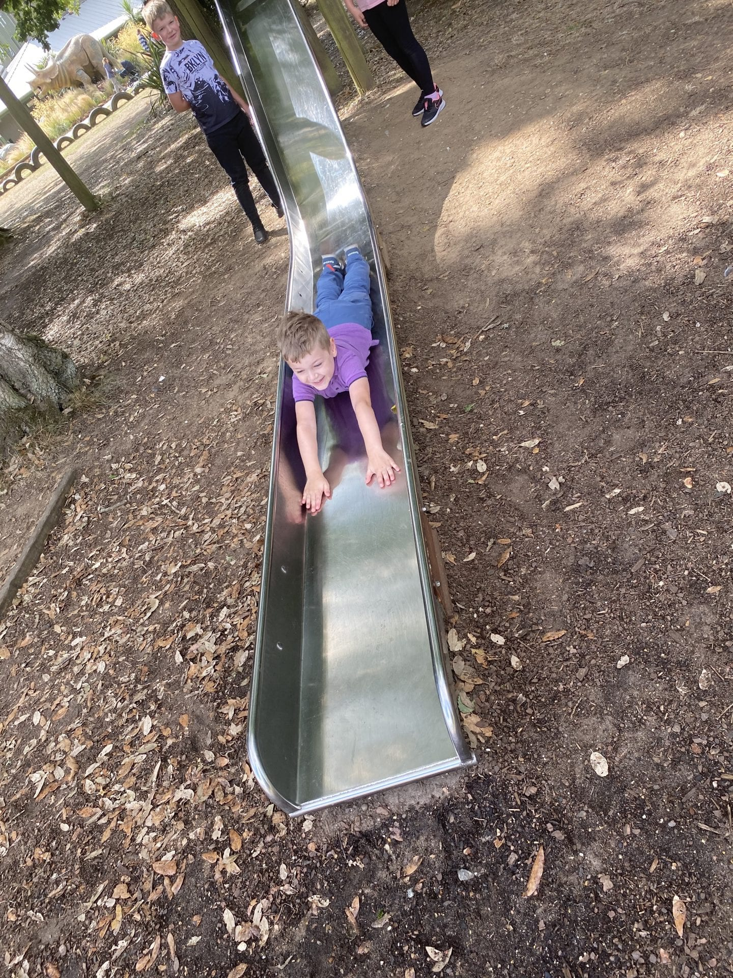 boy coming down a slide