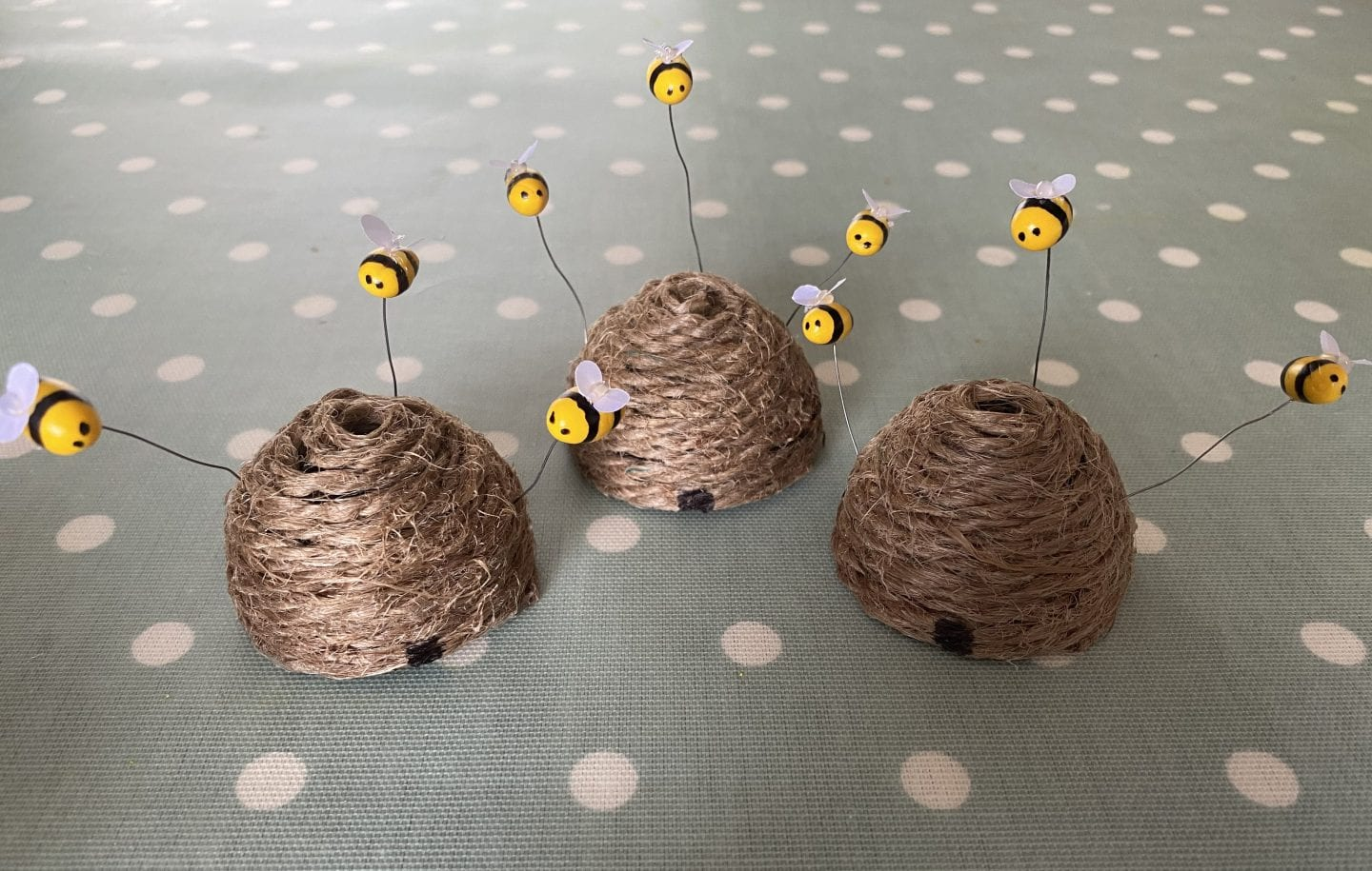 finished mini bee skeps with polymer clay bees